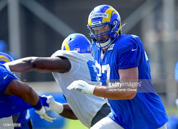 Offensive tackle Andrew Whitworth of the Los Angeles Rams runs a play during training camp on August 19, 2020 at the practice facility at in Thousand...