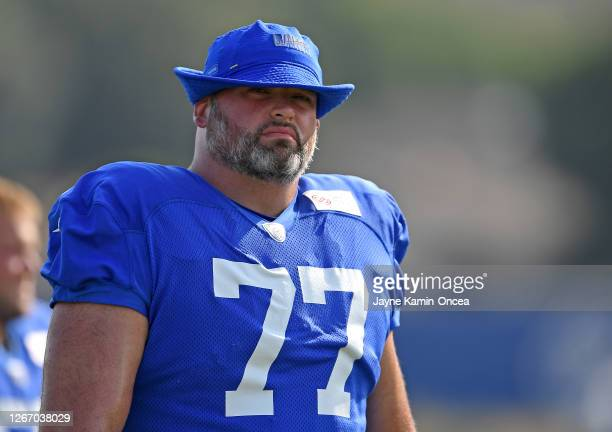 Offensive tackle Andrew Whitworth of the Los Angeles Rams walks on to the field for training camp on August 18, 2020 at the Rams training facility in...