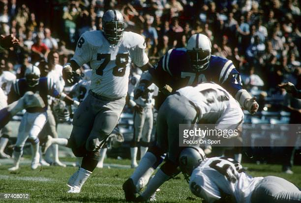 Offensive tackle Art Shell of the Oakland Raiders in action as Ken Novak of the Baltimore Colts sacks Quarterback Ken Stabler December 24 1977 during...