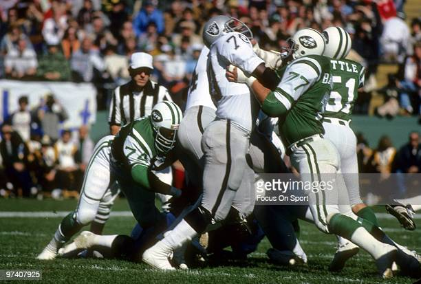 Offensive tackle Art Shell of the Oakland Raiders in action blocks defensive tackle Carl Barzilauskas of the New York Jets October 23 1977 during an...