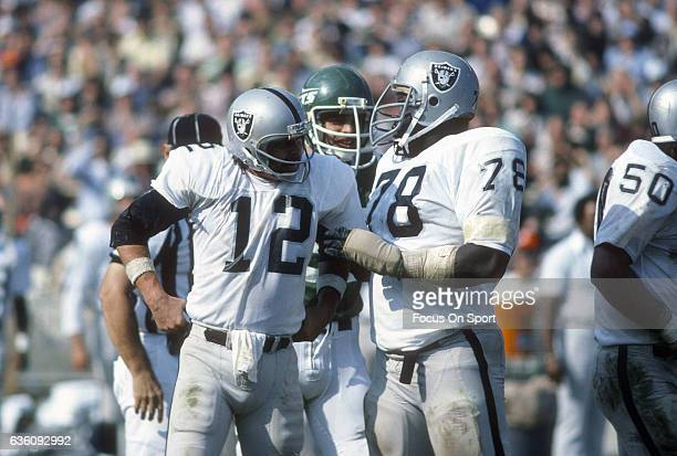 Offensive tackle Art Shell of the Oakland Raiders talks with quarterback Ken Stabler while there's a break in the action against the New York Jets...