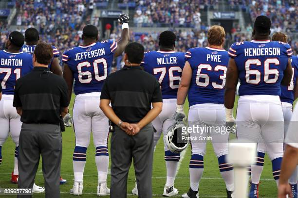 Offensive tackle Cameron Jefferson of the Buffalo Bills raises his arm and makes a fist during the national anthem before playing against the...