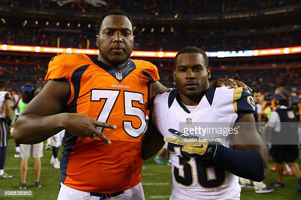 Offensive tackle Cameron Jefferson of the Denver Broncos and Defensive back Rohan Gaines of the Los Angeles Rams pose at Sports Authority Field at...