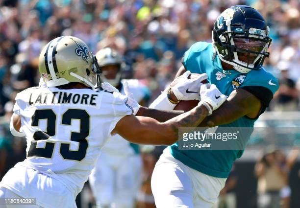 Offensive tackle Cedric Ogbuehi of the Jacksonville Jaguars makes a catch for a first down against cornerback Marshon Lattimore of the New Orleans...