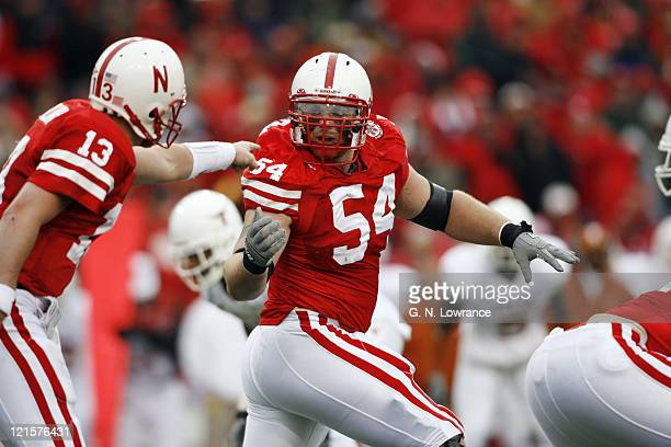 Offensive tackle Chris Patrick of Nebraska gets instructions from Zac Taylor during action between the Texas Longhorns and Nebraska Cornhuskers on...