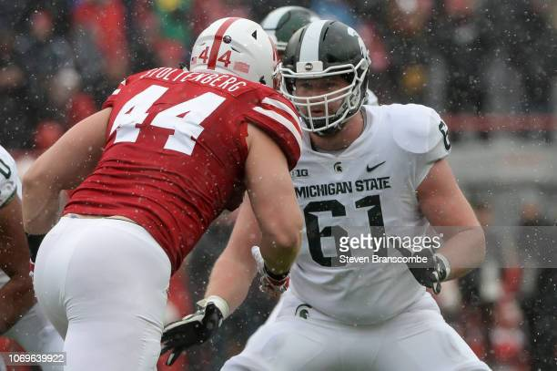 Offensive tackle Cole Chewins of the Michigan State Spartans blocks defensive lineman Mick Stoltenberg of the Nebraska Cornhuskers at Memorial...