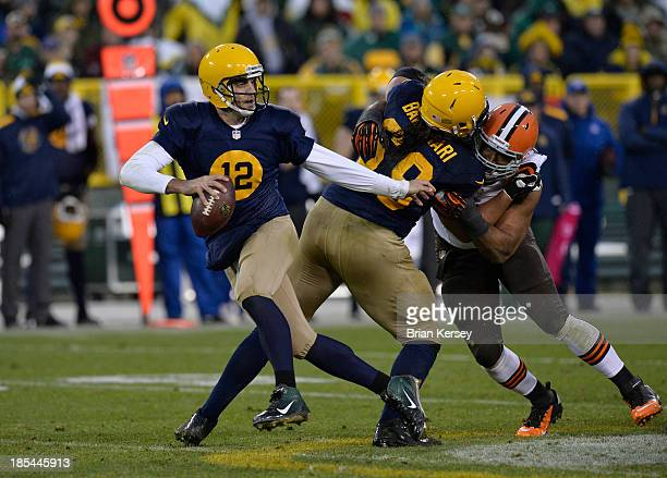 Offensive tackle David Bakhtiari of the Green Bay Packers holds defensive end Desmond Bryant of the Cleveland Browns as quarterback Aaron Rodgers...