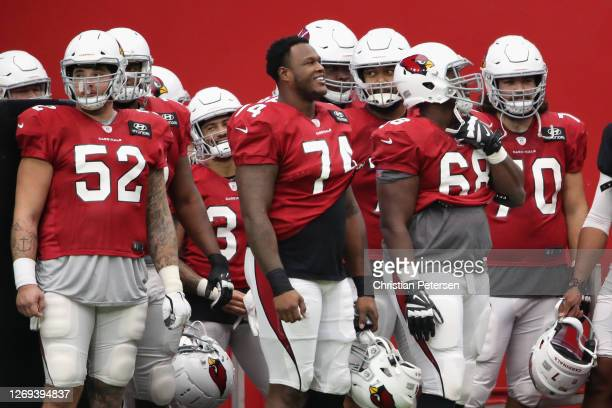 Offensive tackle D.J. Humphries of the Arizona Cardinals stands with teammates during the Red & White Practice at State Farm Stadium on August 28,...