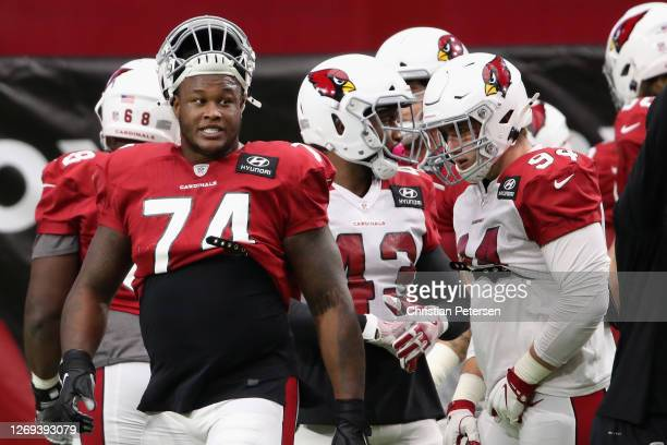 Offensive tackle D.J. Humphries of the Arizona Cardinals talks with defensive end Zach Allen during the Red & White Practice at State Farm Stadium on...