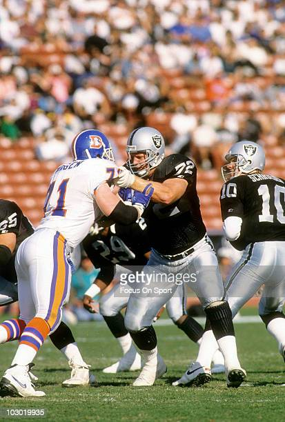 Offensive Tackle Don Mosbar of the Los Angeles Raiders protecting quarterback Jay Schroeder blocks defensive tackle Greg Kragen of the Denver Broncos...