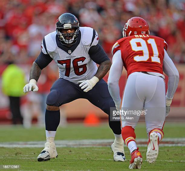 Offensive tackle Duane Brown of the Houston Texans gets set to block linebacker Tamba Hali of the Kansas City Chiefs during the first half on October...