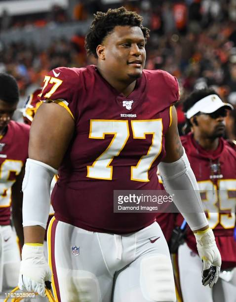Offensive tackle Ereck Flowers of the Washington Redskins walks off the field at halftime of a preseason game against the Cleveland Browns on August...