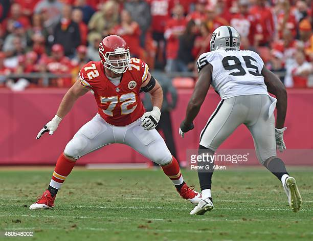 Offensive tackle Eric Fisher of the Kansas City Chiefs gets set to block defensive end Benson Mayowa of the Oakland Raiders during the first half on...