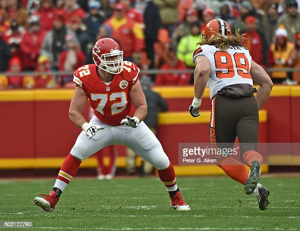 Offensive tackle Eric Fisher of the Kansas City Chiefs gets set to block linebacker Paul Kruger of the Cleveland Browns during the first half on...