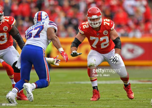 Offensive tackle Eric Fisher of the Kansas City Chiefs gets set to block linebacker Lorenzo Alexander of the Buffalo Bills during the first half at...