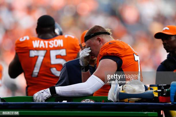 Offensive tackle Garett Bolles of the Denver Broncos reacts after getting injured against the Dallas Cowboys at Sports Authority Field at Mile High...