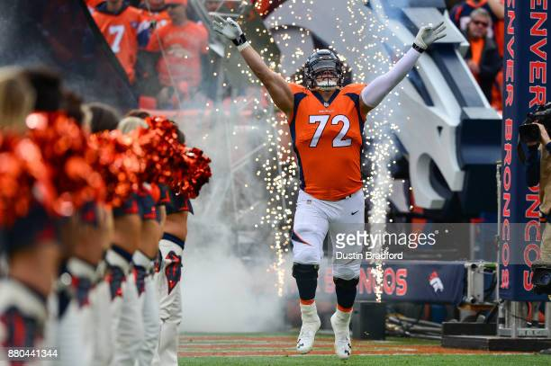 Offensive tackle Garett Bolles of the Denver Broncos runs onto the field during player introductions before a game against the Cincinnati Bengals at...