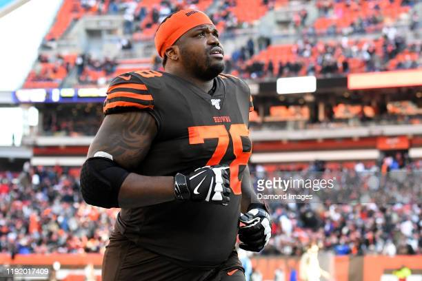 Offensive tackle Greg Robinson of the Cleveland Browns runs off the field at halftime of a game against the Baltimore Ravens on December 22 2019 at...