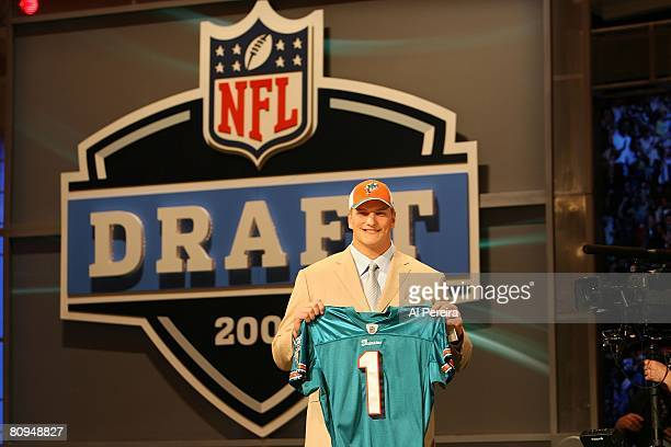 Offensive Tackle Jake Long of Michigan holds up a jersey after being selected by the Miami Dolphins with the No.1 overall pick of the 2008 National...