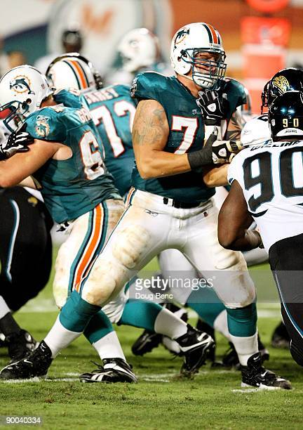 Offensive tackle Jake Long of the Miami Dolphins drops back to block against the Jacksonville Jaguars during a preseason game at Landshark Stadium on...