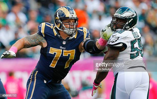 Offensive tackle Jake Long of the St Louis Rams blocks linebacker Trent Cole of the Philadelphia Eagles in the third quarter on October 5 2014 at...
