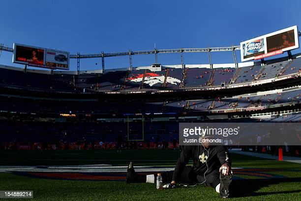 Offensive tackle Jermon Bushrod of the New Orleans Saints stretches on the field before a game against the Denver Broncos at Sports Authority Field...