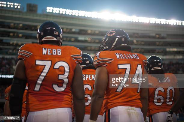 Offensive tackle J'Marcus Webb and guard Chris Williams of the Chicago Bears look on from the sidelines during the game against the Detroit Lions at...