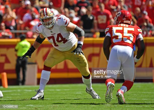 Offensive tackle Joe Staley of the San Francisco 49ers gets set to block linebacker Dee Ford of the Kansas City Chiefs during the first half on...