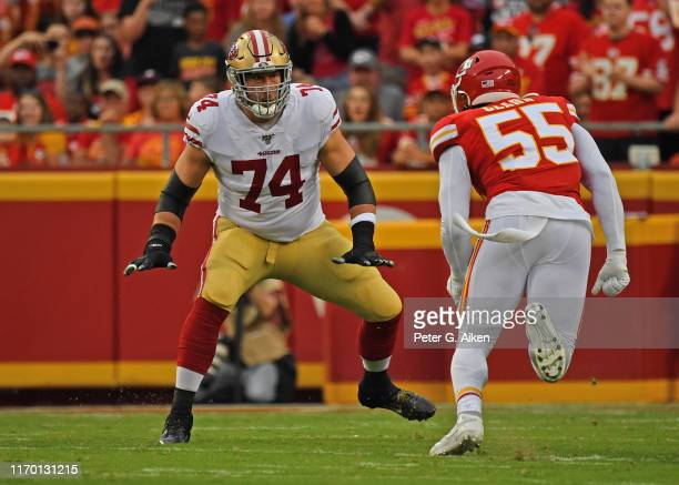 Offensive tackle Joe Staley of the San Francisco 49ers gets set to block defensive end Frank Clark of the Kansas City Chiefs during the first half of...