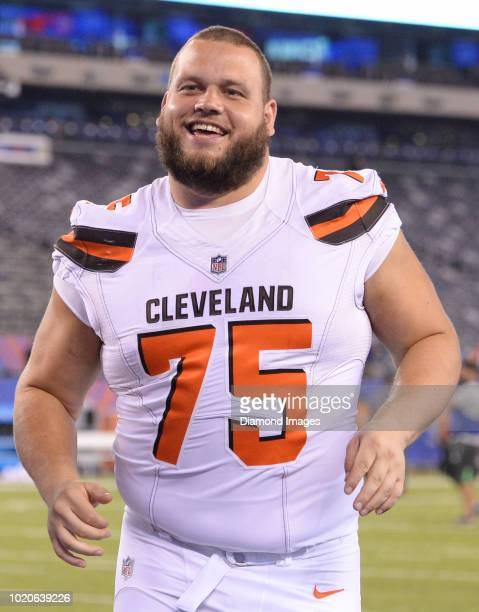 Offensive tackle Joel Bitonio of the Cleveland Browns smiles as he runs off the field after a preseason game against the New York Giants at MetLife...