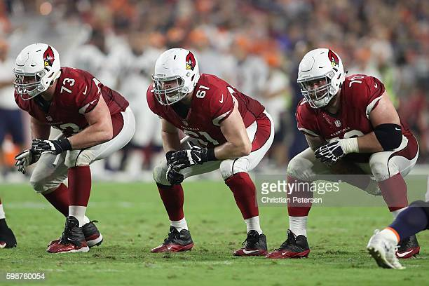 Offensive tackle John Wetzel offensive guard Cole Toner and center Evan Boehm of the Arizona Cardinals during the preseaon NFL game against the...