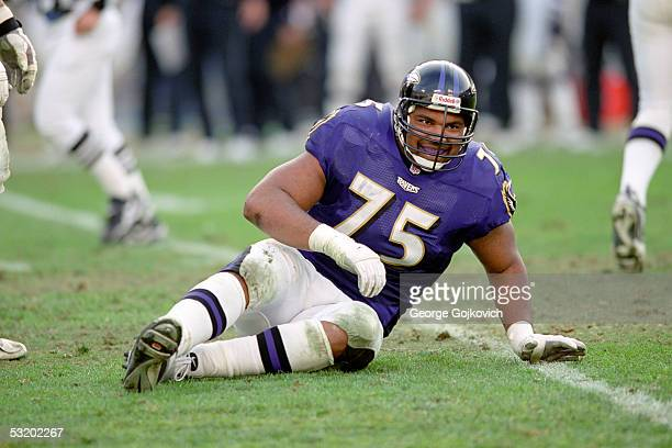Offensive tackle Jonathan Ogden of the Baltimore Ravens smiles while on the ground after a play against the Tennessee Titans at PSINet Stadium on...