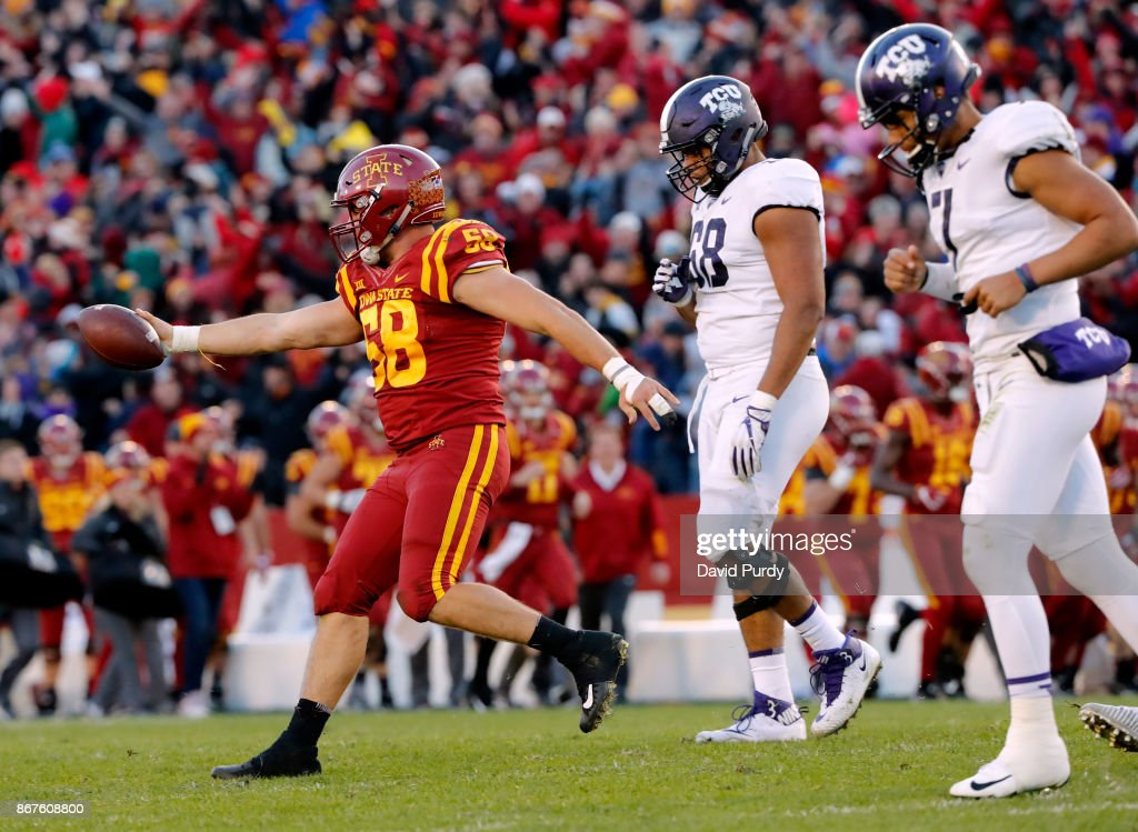 Offensive tackle Joseph Noteboom #68 of the TCU Horned Frogs watches on as defensive end J.D. Waggoner #58 of the Iowa State Cyclones celebrates after recovering a fumble by quarterback Kenny Hill #7 of the TCU Horned Frogs in the second half of play at Jack Trice Stadium on October 28, 2017 in Ames, Iowa. The Iowa State Cyclones won 14-7 over the TCU Horned Frogs.