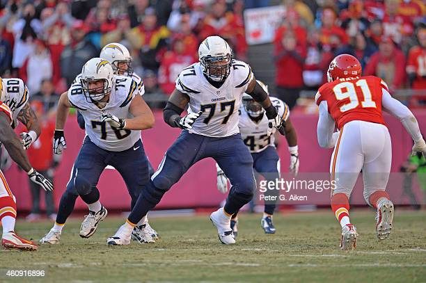 Offensive tackle King Dunlap of the San Diego Chargers gets set to block linebacker Tamba Hali of the Kansas City Chiefs during the second half on...