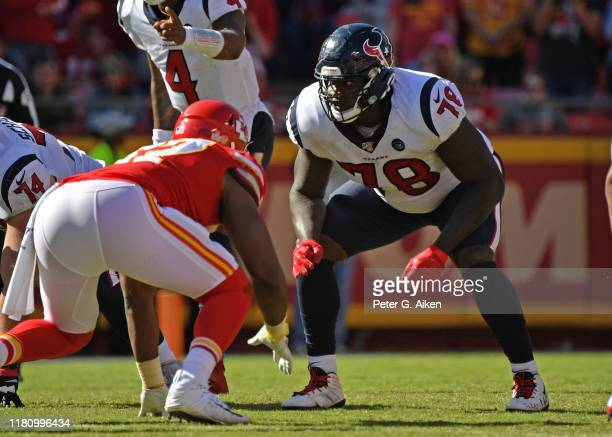 Offensive tackle Laremy Tunsil of the Houston Texans gets set on the line against the Kansas City Chiefs during the second half at Arrowhead Stadium...