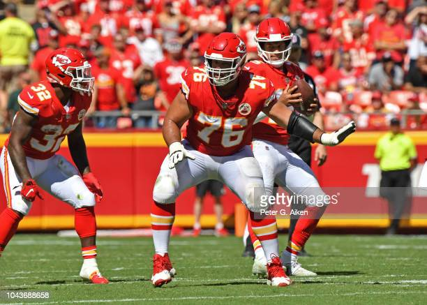 Offensive tackle Laurent DuvernayTardif of the Kansas City Chiefs gets set to pass block against the San Francisco 49ers during the first half on...