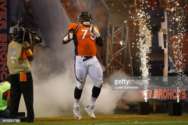 Offensive tackle Menelik Watson of the Denver Broncos is introduced to the game against the Los Angeles Chargers at Sports Authority Field at Mile...