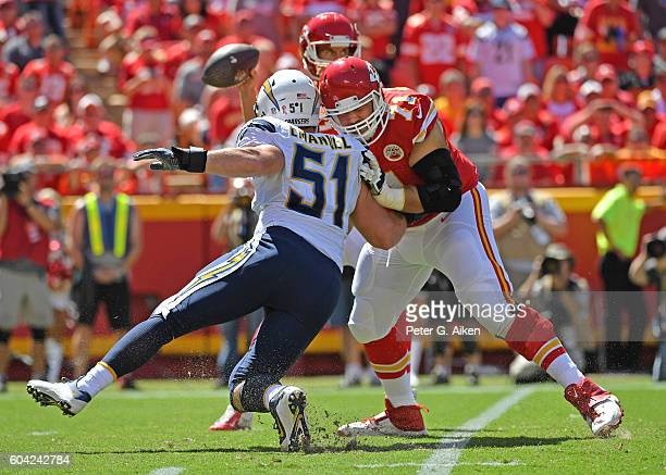 Offensive tackle Mitchell Schwartz of the Kansas City Chiefs pass blocks linebacker Kyle Emanuel of the San Diego Chargers during the second half on...
