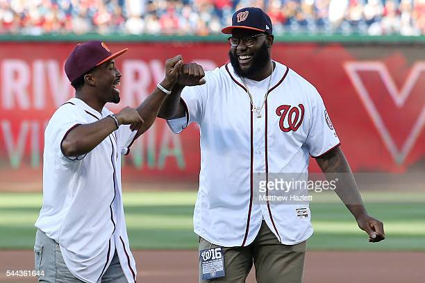 Offensive Tackle Morgan Moses of the Washington Redskins and cornerback Kendall Fuller smile after throwing out the first pitch at Nationals Park on...