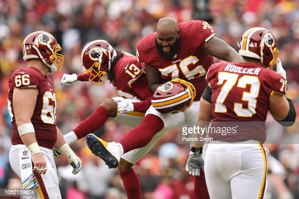 Offensive tackle Morgan Moses of the Washington Redskins and wide receiver Maurice Harris celebrate after the Carolina Panthers turned the ball over...