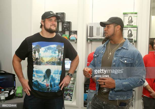 Offensive tackle Rob Havenstein and NFL guard Roger Saffold attend the LA Rams Wives and Girlfriends Holiday Gifting Event at Westfield Topanga Mall...