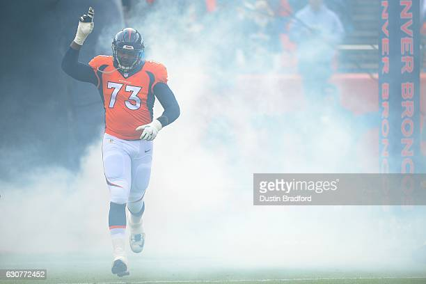 Offensive tackle Russell Okung of the Denver Broncos is introduced to the game against the Oakland Raiders at Sports Authority Field at Mile High on...