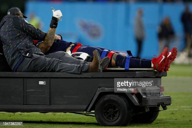 Offensive tackle Taylor Lewan of the Tennessee Titans is carted off after being injured against the Buffalo Bills during the first half at Nissan...