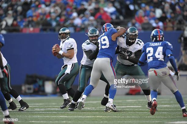 Offensive tackle Todd Herremans and offensive tackle Tra Thomas of the Philadelphia Eagles block during the game against the New York Giants on...