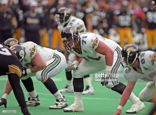 Offensive tackle Tony Boselli of the Jacksonville Jaguars looks across the line of scrimmage as he prepares to block during a game against the...