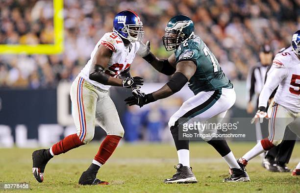 Offensive Tackle Tra Thomas of the Philadelphia Eagles blocks against Mathias Kiwanuka of the New York Giants during the game at Lincoln Financial...