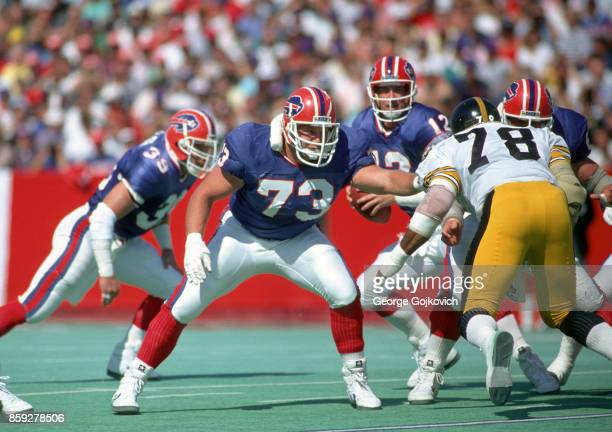 Offensive tackle Will Wolford of the Buffalo Bills blocks against defensive lineman Tim Johnson of the Pittsburgh Steelers as quarterback Jim Kelly...