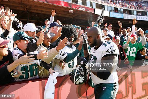 Offensive tackle William Thomas of the Philadelphia Eagles celebrates with fans after a game against the San Francisco 49ers on October 12 2008 at...