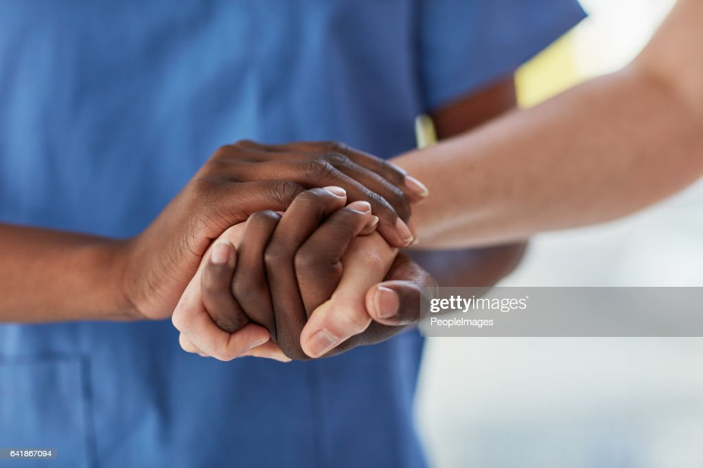 Offering a patient the care and comfort they need : Stock Photo