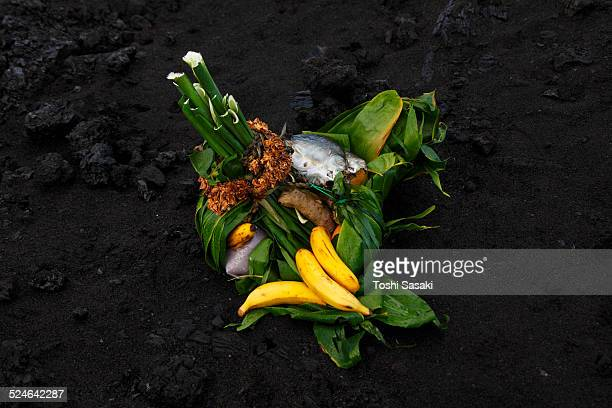 offering for goddess pele at lava ocean entry. - pele goddess stock pictures, royalty-free photos & images